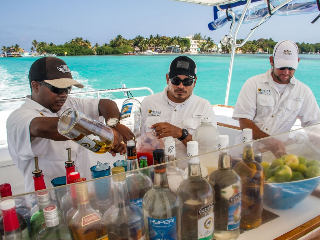 Our crew hard at work creating our Handcrafted Fresh Fruit Cocktails to order for our guests